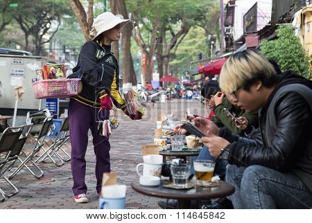 Asian vendor selling CD and DVD disk without copyright on the sidewalk