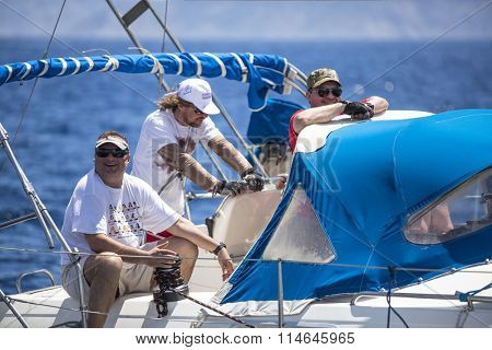 METHANA - POROS - ERMIONI, GREECE - CIRCA MAY, 2014: Sailors participate in sailing regatta 11th Ellada 2014 among Greek island group in the Aegean Sea, in Cyclades and Argo-Saronic Gulf.