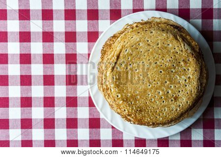 Stack of pancakes on white plate