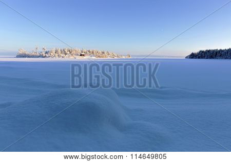 Frozen lake and blue sky