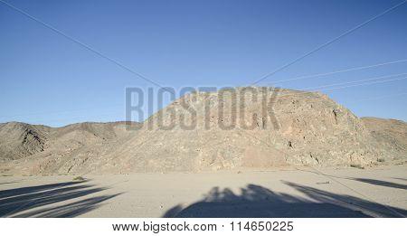 Sahara Rocks And Hills With Trees Shadows