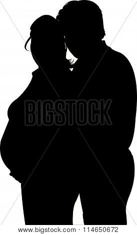 Silhouette of the pregnant woman and husband