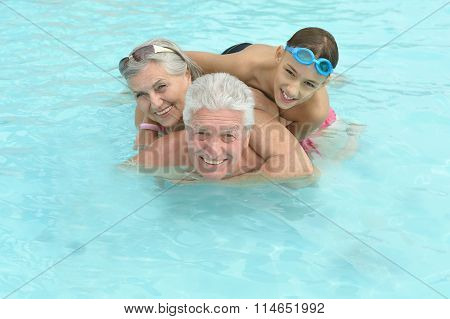 Happy Elderly couple with grandson