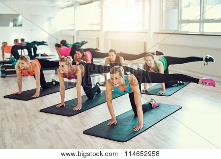 Teamwork Of Young Women Doing Exercise Together