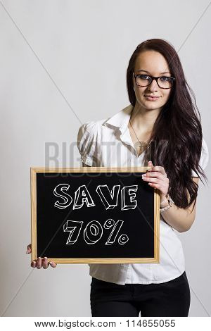 Save 70 Percent - Young Businesswoman Holding Chalkboard