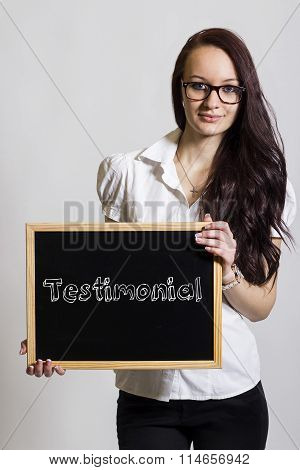 Testimonial - Young Businesswoman Holding Chalkboard