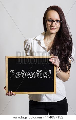 Potential - Young Businesswoman Holding Chalkboard