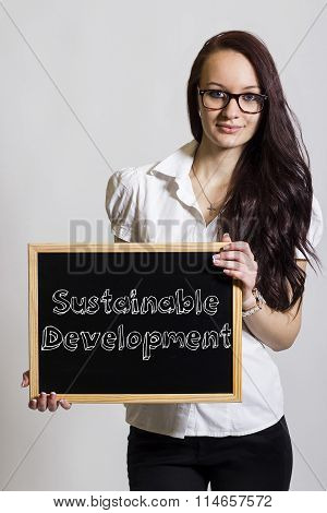 Sustainable Development - Young Businesswoman Holding Chalkboard