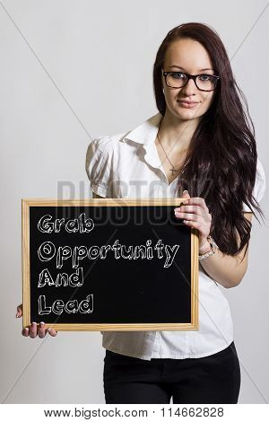 Grab Opportunity And Lead Goal - Young Businesswoman Holding Chalkboard