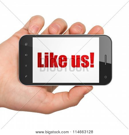 Social network concept: Hand Holding Smartphone with Like us on display