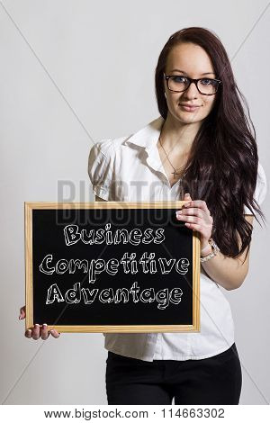 Business Competitive Advantage - Young Businesswoman Holding Chalkboard