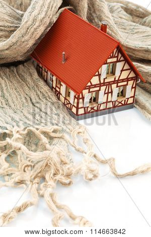 house with scarf. symbolfoto insulation