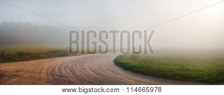 Gravel Road In The Fog