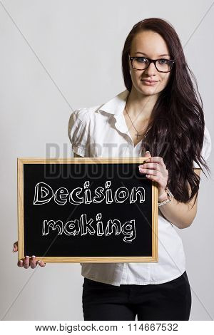 Decision Making - Young Businesswoman Holding Chalkboard