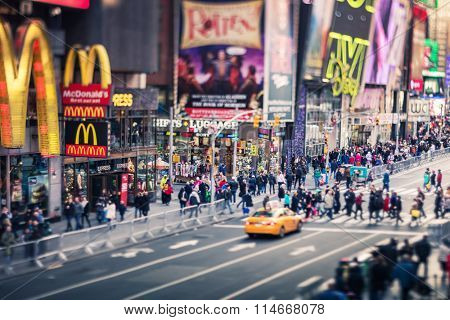 New York City - Times Square with Yellow Cab and many people, tilt-shift lens, 19 of December 2015
