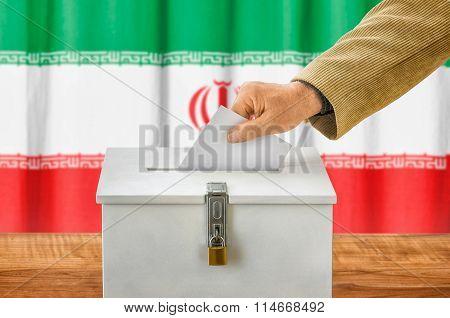 Man Putting A Ballot Into A Voting Box - Iran