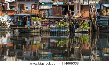 HO CHI MINH, VIETNAM - JAN 11, 2016: Floating market with reflection in water. Is located in the South of Vietnam, is the country's largest city, population 8 million.
