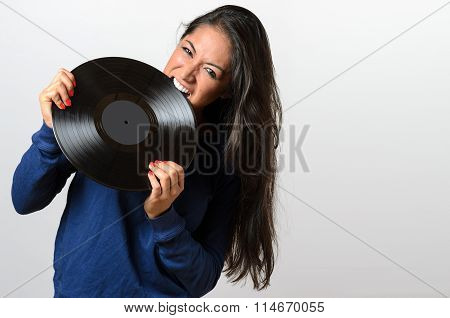 Frustrated Woman Biting On A Vinyl Record