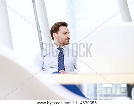 Business Person Thinking In Office