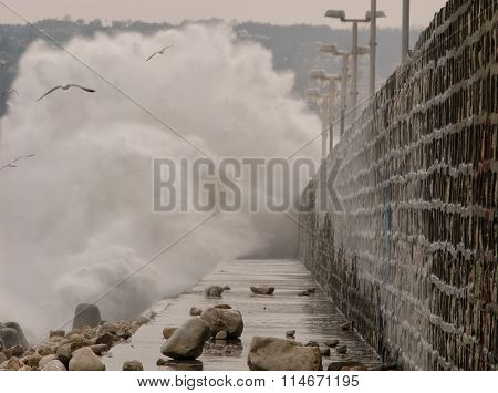 Big waves against sea pier.