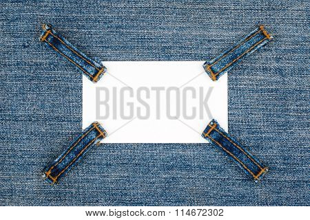 Business Card With Four Straps Jeans, Lies On The Light Denim