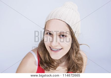 Dental Concepts And Ideas. Caucasian Female Teenager With Teeth Brackets And Hat