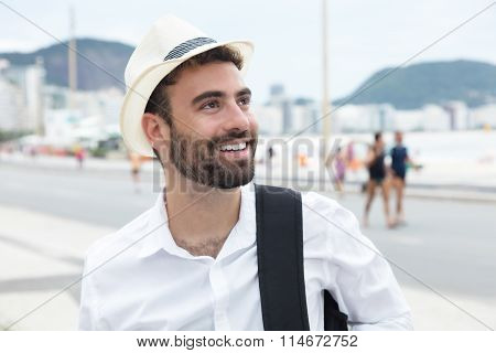 Tourist With Hat Looking Around