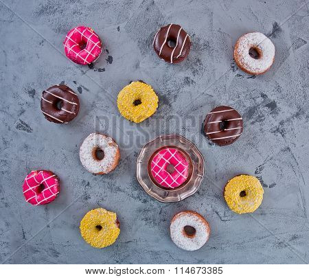 Glazed Doughnuts With Colourful Sprinkles On Dark Background