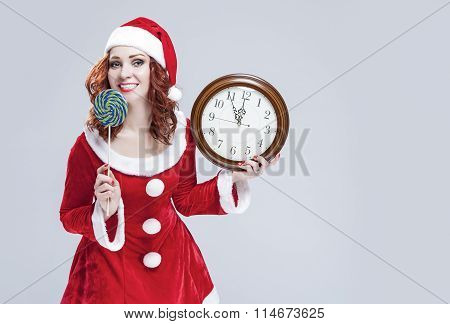 Christmas Holiday Concept And Ideas. Portrait Of Gleeful Red-haired Santa Helper With Iced Lolly And
