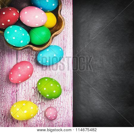 Colorful Easter Eggs And Cutlery On A Black Background