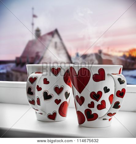 Two Cups With Hearts On The Window
