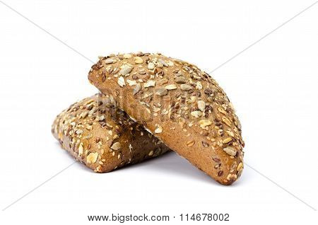 Dark Buns With Sunflower Seeds, Sesame And Flax. White Background