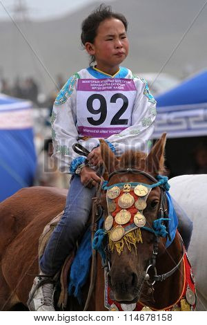 A Young Girl Rides