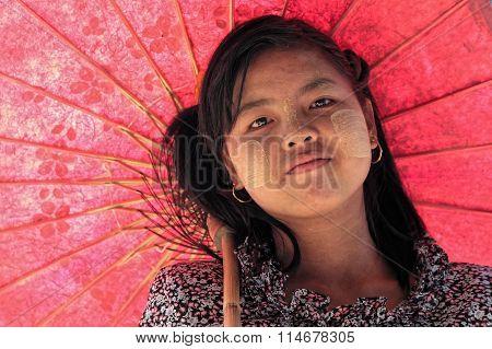 Red Umbrella and Thanaka