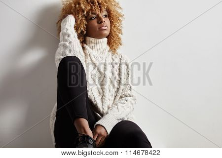 Black Woman With A Blond Afra Watching Aside