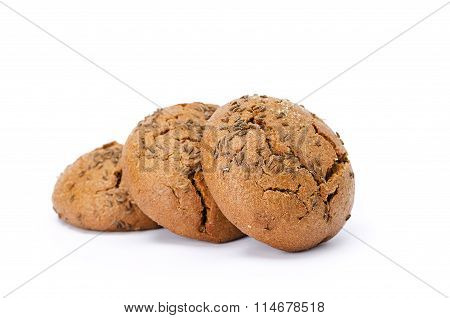 The Dark Round Buns With Caraway Seeds. On White Background