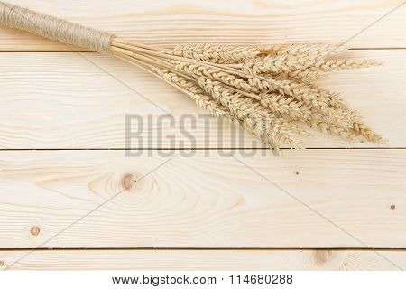 Sheaf Of Wheat Over Wood Background. Harvest Concept. Top View