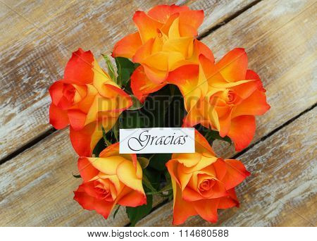 Gracias (thank you in Spanish) card with orange roses bouquet