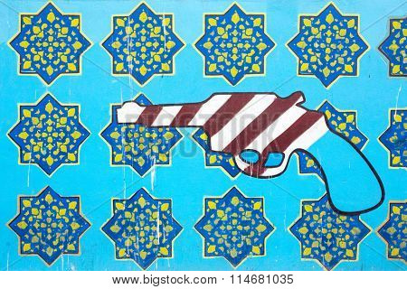 Tehran, Iran - December 7, 2015: Anti-American graffiti on the wall of Iran's Former American Embassy in Tehran