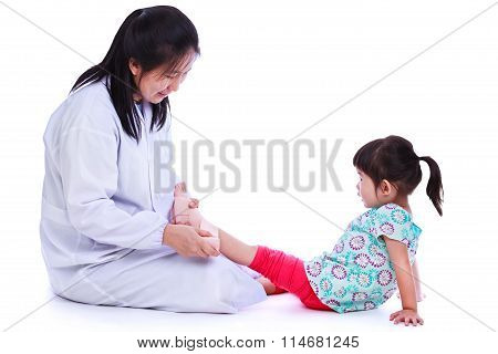 Child Trauma Medical Treatment Concept. Isolated On White.