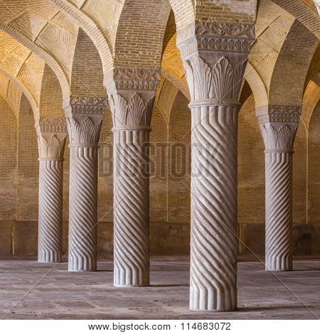 Shiraz, Iran - December 26, 2015: Beautiful columns in Vakil Mosque, Shiraz, Iran