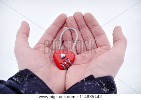 Red Heart-shaped Combination Lock at man's palms