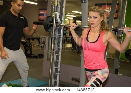 Woman Weight Training At Gym.exercising On Pull Down Weight Machine.woman Doing Pull-ups Exercising