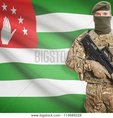Soldier Holding Machine Gun With Flag On Background Series - Abkhazia