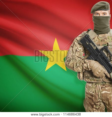 Soldier Holding Machine Gun With Flag On Background Series - Burkina Faso
