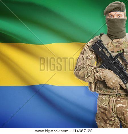 Soldier Holding Machine Gun With Flag On Background Series - Gabon