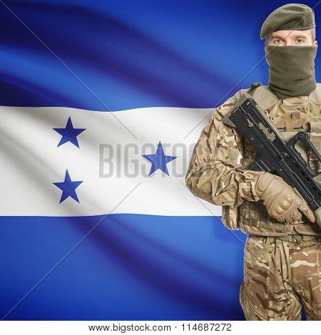 Soldier Holding Machine Gun With Flag On Background Series - Honduras