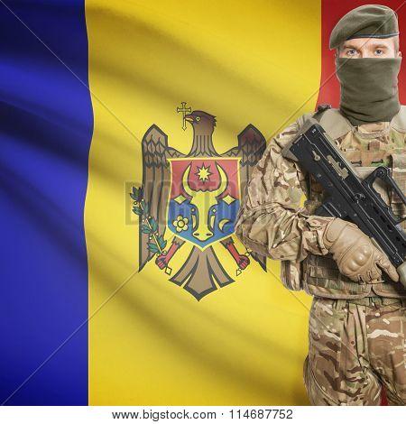 Soldier Holding Machine Gun With Flag On Background Series - Moldova