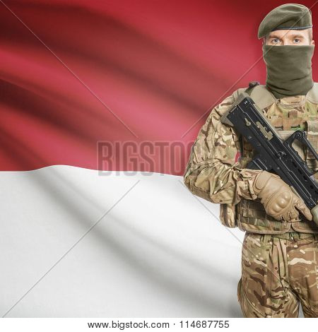 Soldier Holding Machine Gun With Flag On Background Series - Monaco