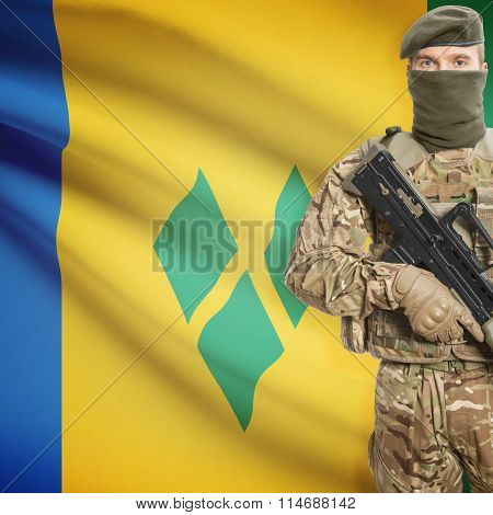 Soldier Holding Machine Gun With Flag On Background Series - Saint Vincent And The Grenadines